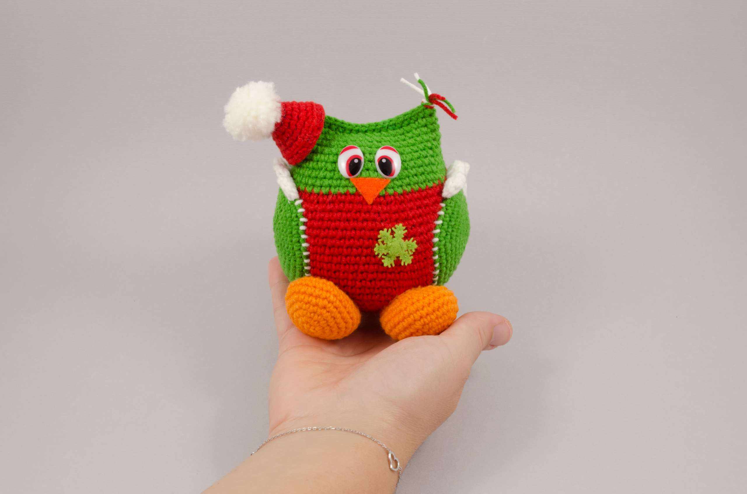 holding in hand amigurumi christmas owl