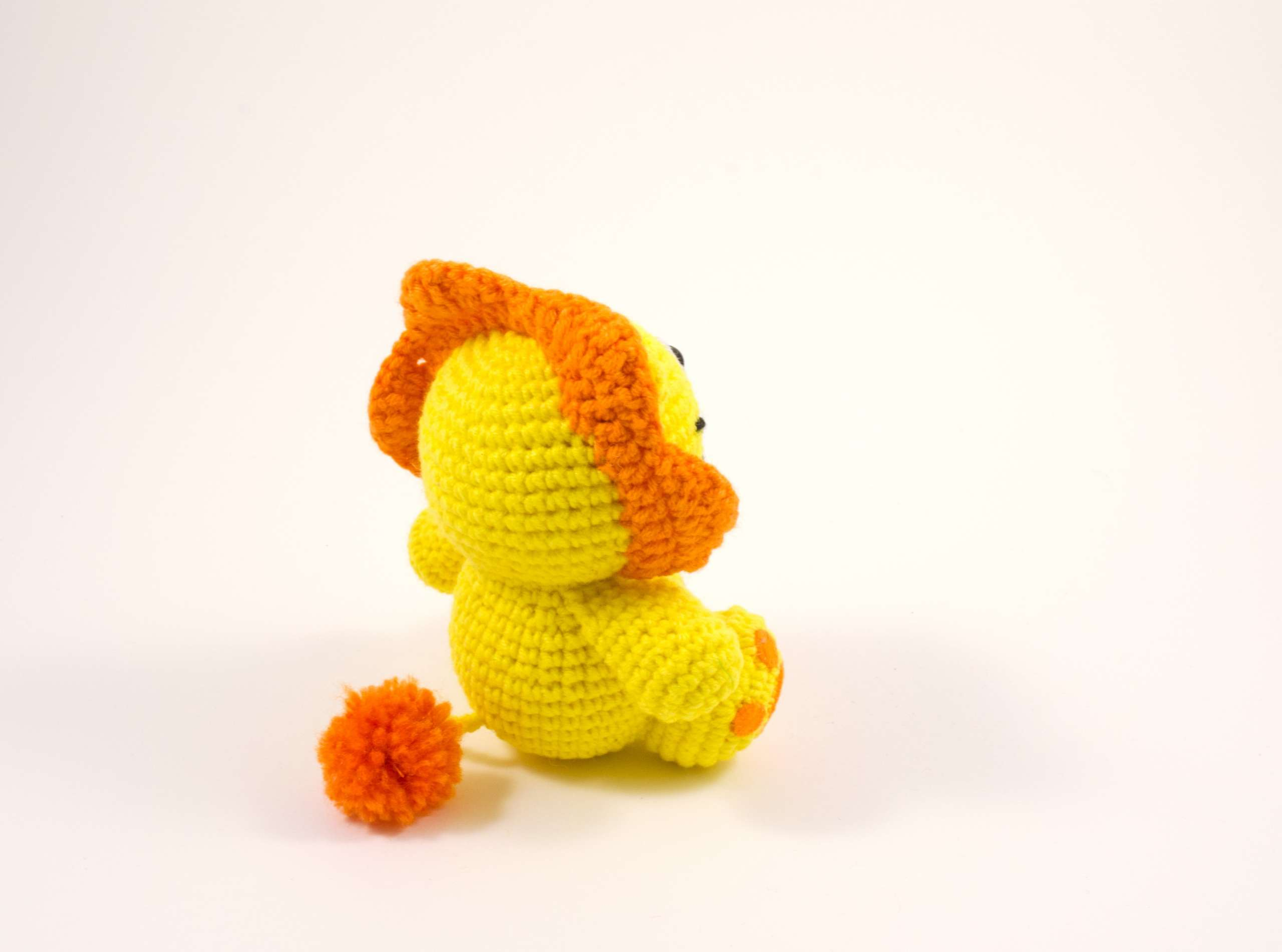 crochet lion toy back view