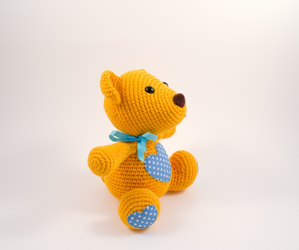 amigurumi orange teddy bear side view
