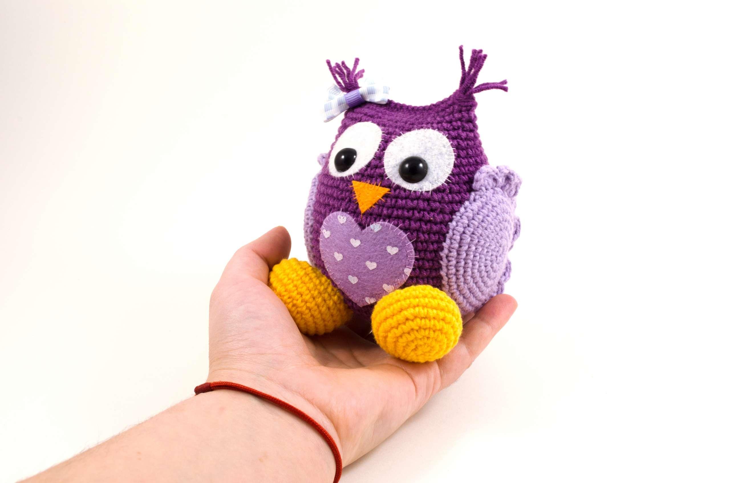 holding in hand crochet purple owl