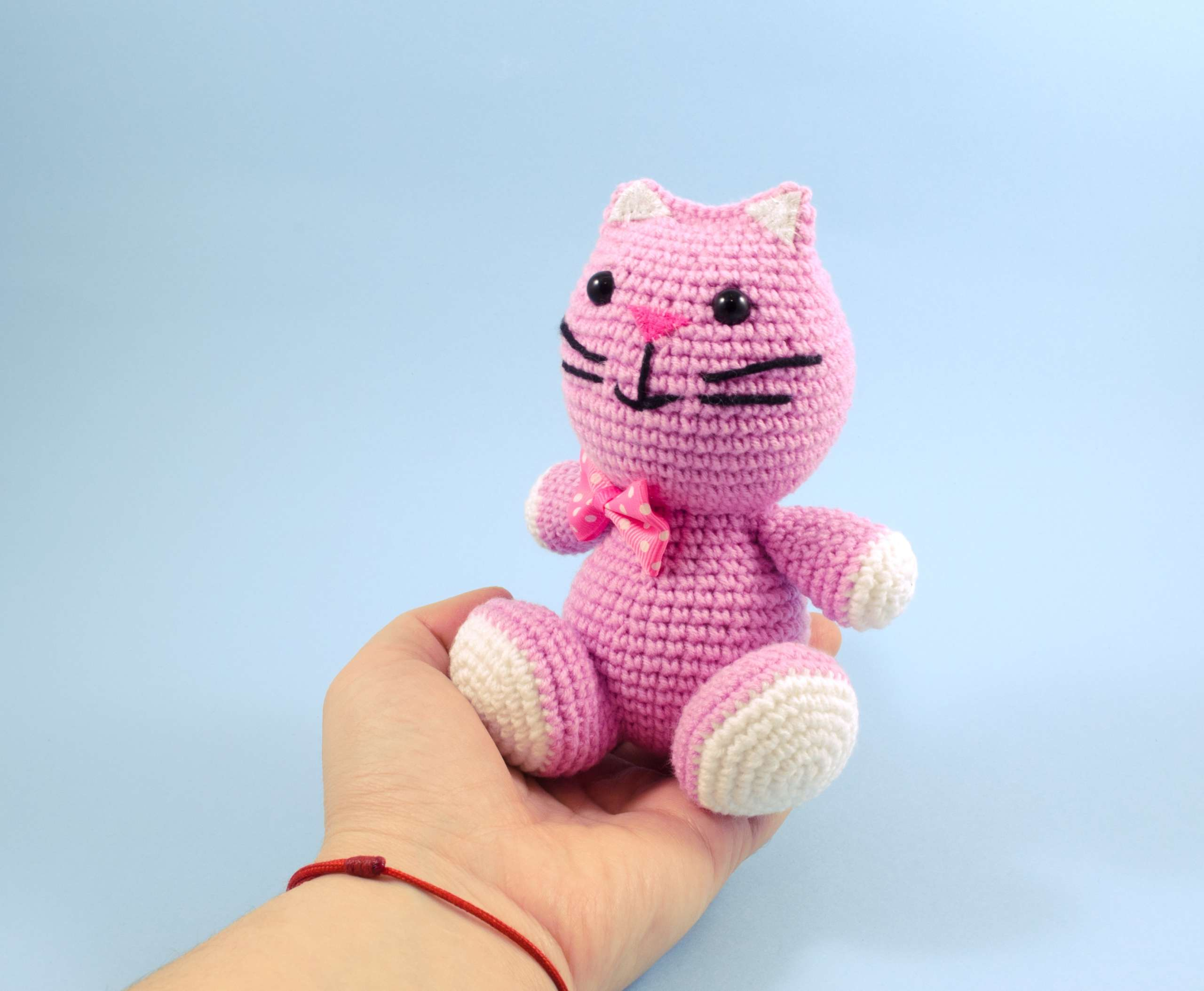 holding in hand crochet pink kitten