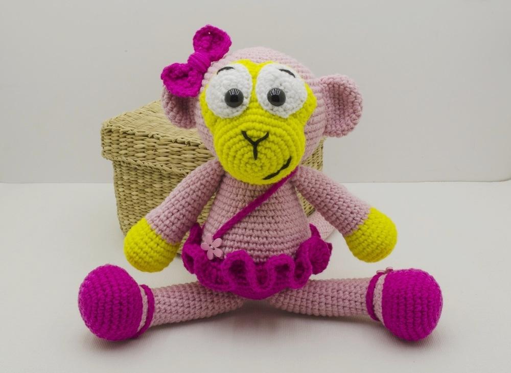 crochet pink monkey in sitting position
