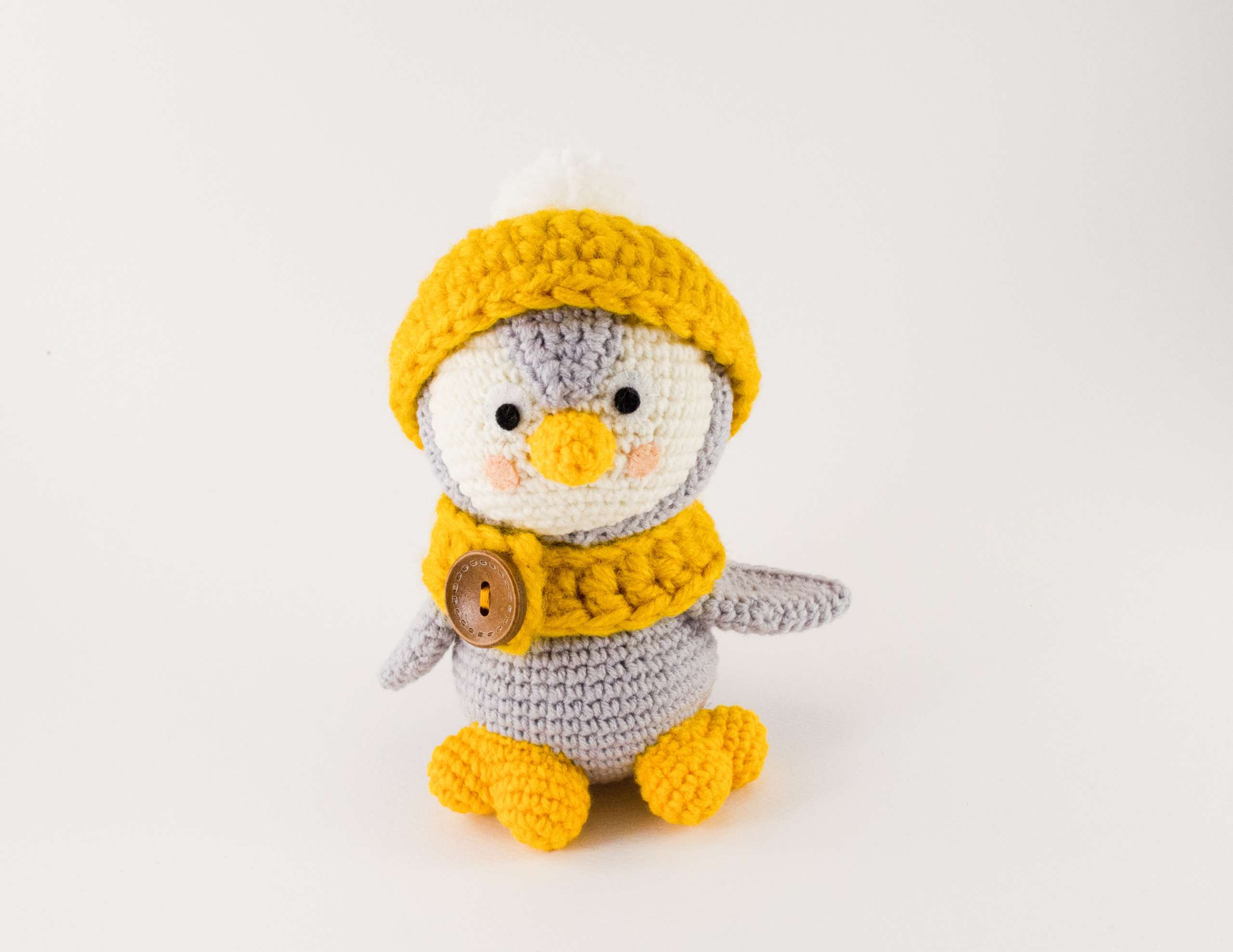 grey penguin with hat